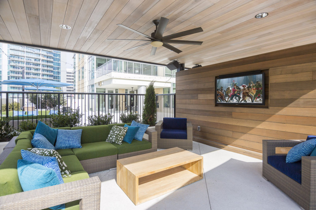 Rooftop deck with fireside lounging, gaming, al fresco dining and HDTVs at Alexan on 8th Luxury Apartment Community