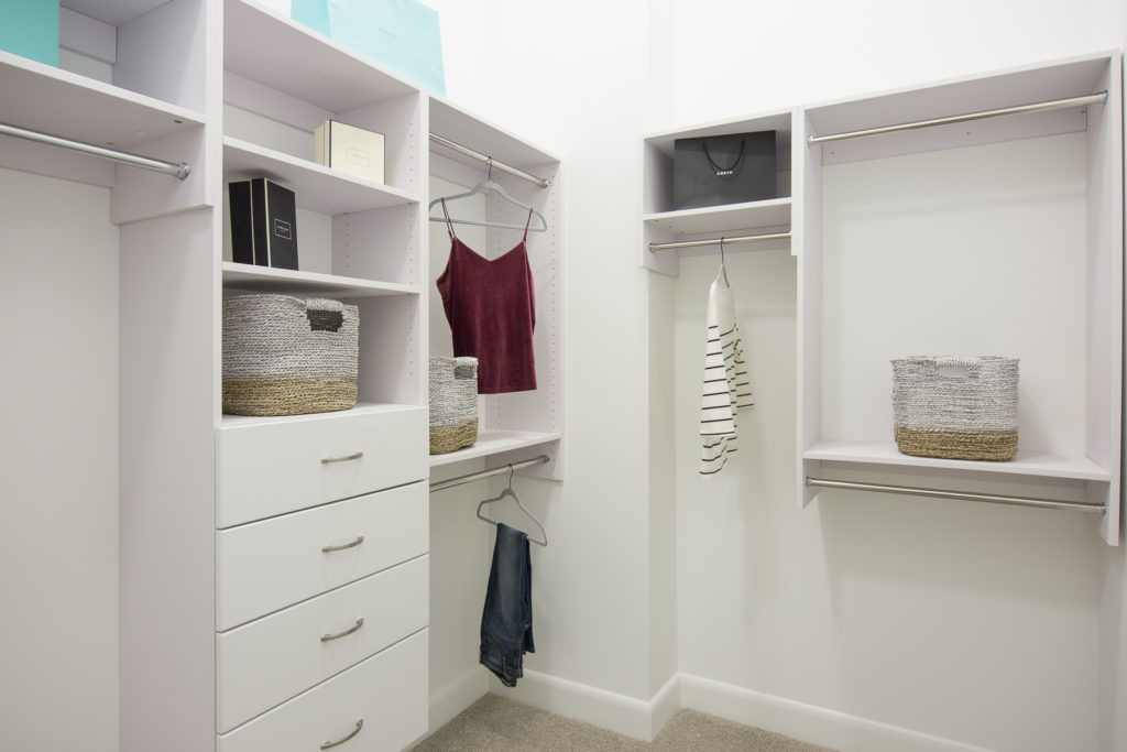 Custom tailored walk-in closets at Alexan on 8th Luxury Apartment Community