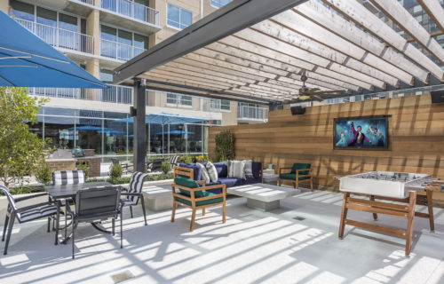 Put the Fun Back Into Your Weekends - poolside lounge area with flatscreen