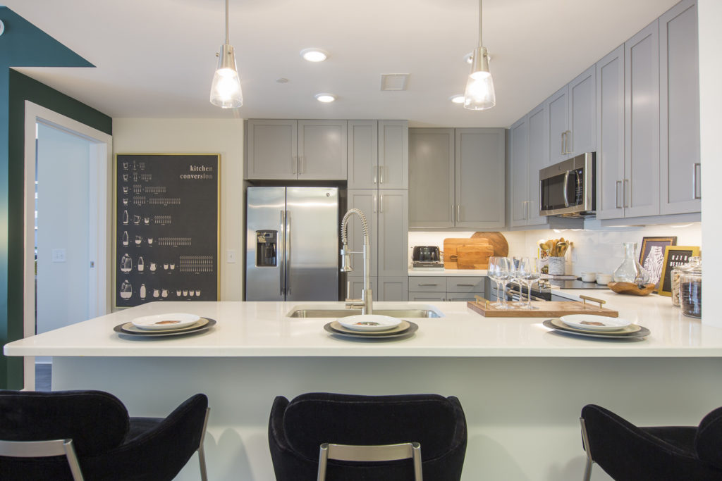 gourmet kitchen with stainless steel appliances and pendant lighting - Atlanta Apartment with Terrific Tech